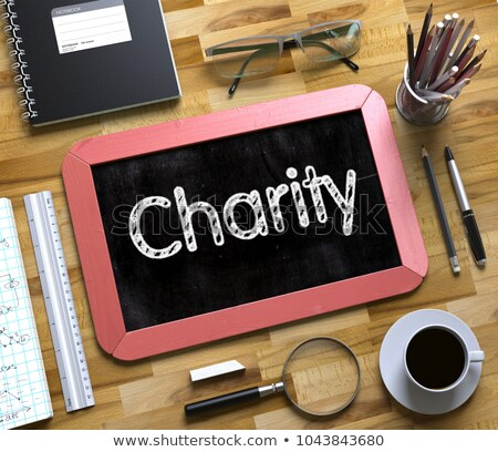 Charity Concept on Small Chalkboard. 3d Stock photo © tashatuvango