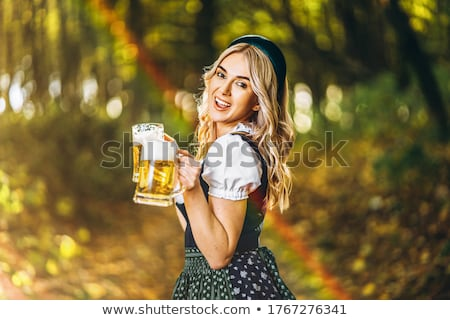 Oktoberfest girl and beer mug. National Beer Festival in Germany Stock photo © popaukropa