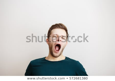 Young man yawning Stock photo © IS2