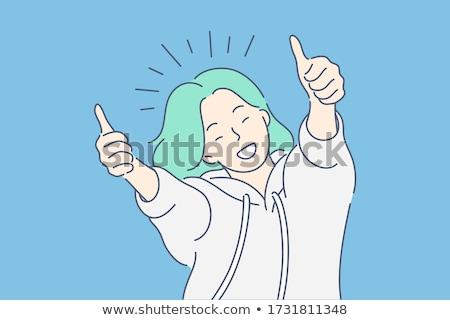 joyful woman winning hand gesture up stock photo © studiostoks