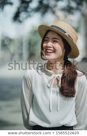 Laughing woman with brown hair clasping hands Stock photo © Giulio_Fornasar