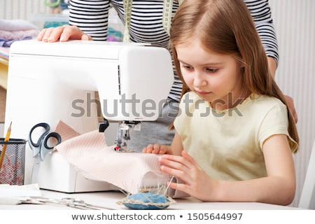 child sewing machine stock photo © supertrooper