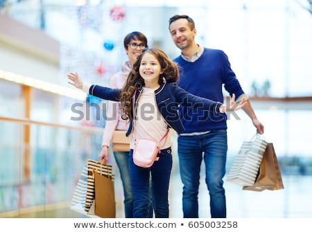 daughter with her father shopping in mall stock photo © kzenon