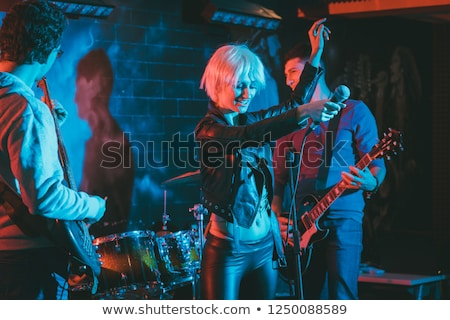 band during gig making rock music on stage stock photo © kzenon