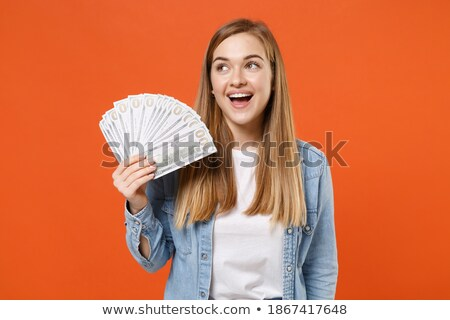Image of young woman 20s wearing casual clothing holding fan of  Stock photo © deandrobot