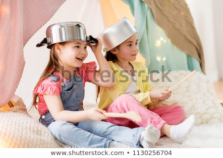 girls with kitchenware playing in tent at home Stock photo © dolgachov