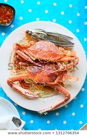 Two freshly cooked crabs on the white plate serviced with white  Stock photo © dashapetrenko