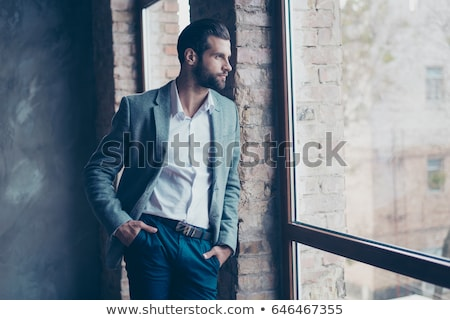 confident smart casual man with hand in pocket  Stock photo © feedough