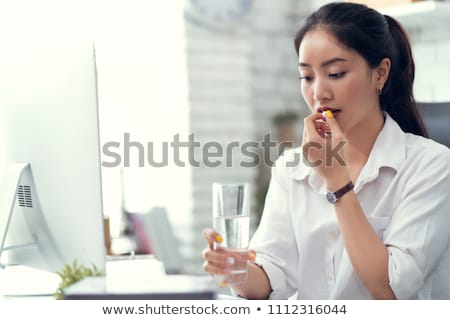 businessman taking medicines in office stock photo © andreypopov