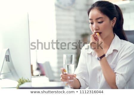 Businessman Taking Medicines In Office Stock photo © AndreyPopov