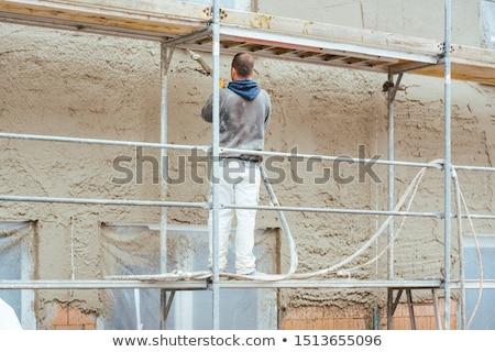 Munkás külső fal újonnan ház építőmunkás Stock fotó © Kzenon