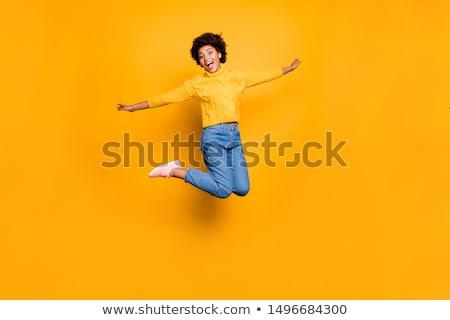 Felice giovane ragazza jumping foresta estate rosso Foto d'archivio © EdelPhoto