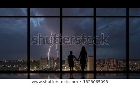 Stock fotó: Sziluett · szerető · pár · ablak · kilátás · éjszaka