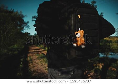 Homem mochila caminhada estrada de terra jovem Foto stock © nito