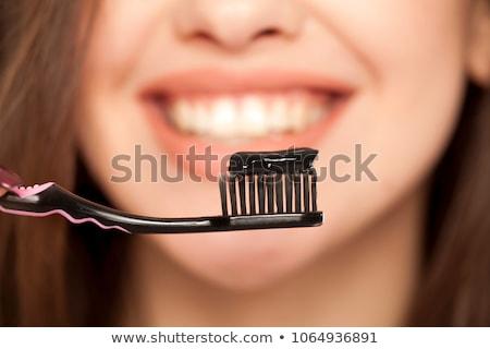 Kadın diş fırçalamak siyah aktif Stok fotoğraf © AndreyPopov
