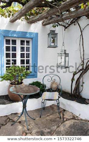 Cozy sitting area in mediterranean garden Stock photo © brebca