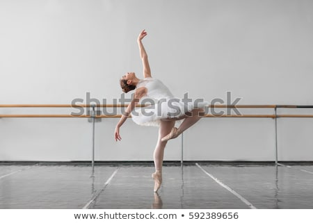 Ballet dancer stretching on floor Stock photo © nyul