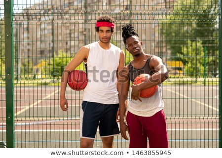 Small group of two young professional basketballers in activewear Stock photo © pressmaster