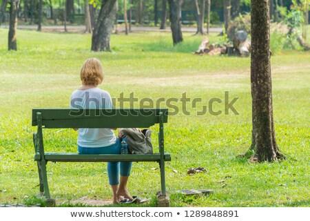 печально старший женщину сидят скамейке лет Сток-фото © dolgachov