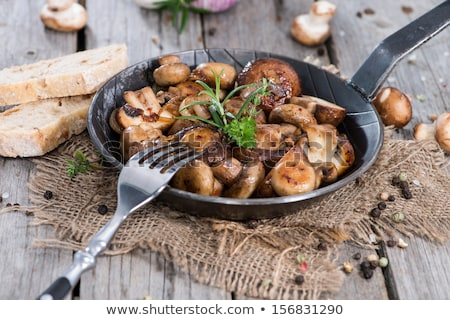 Roasted mushrooms champignons in pan Stock photo © furmanphoto