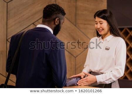 Gelukkig jonge asian receptionist hotel Stockfoto © pressmaster
