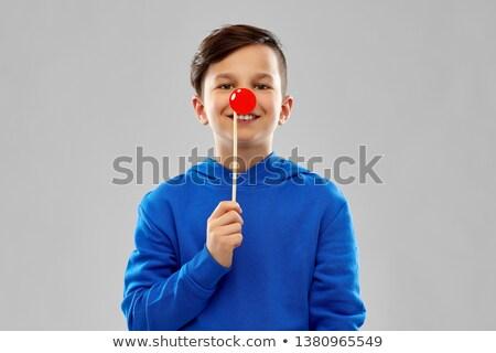 Gülen erkek mavi kırmızı palyaço burun Stok fotoğraf © dolgachov