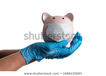 Doctor or Nurse Wearing Surgical Gloves Holding Piggy Bank Weari Stock photo © feverpitch