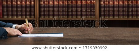 Lawyer Doing Legal Document Scrutiny At Desk Stock photo © AndreyPopov