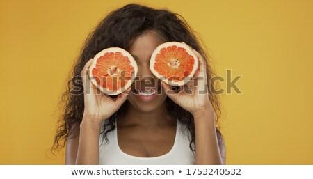 Opgewonden etnische vrouw spelen grapefruit gelukkig Stockfoto © dash