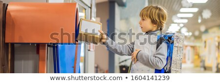 The boy plays that he is a postman BANNER, LONG FORMAT Stock photo © galitskaya