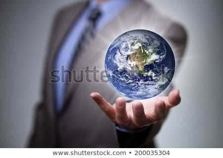 man holding a glowing earth globe in his hand stock photo © rufous