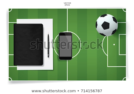 Football and blank notebook on Green Grass background Stock photo © Archipoch