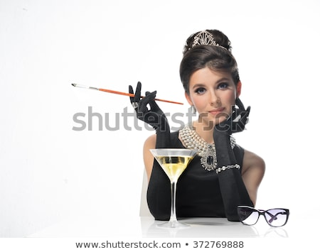 beautiful retro girl in martini glass isolated on white stock photo © lordalea