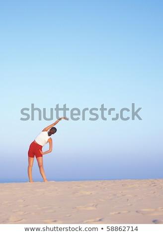 doing exercises sand dunes corralejo fuerteventura canary is stock photo © phbcz