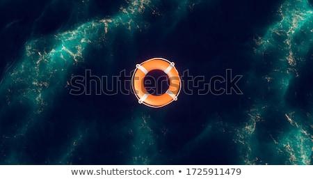 Boya amarillo azul agua ayudar ola Foto stock © Gertje