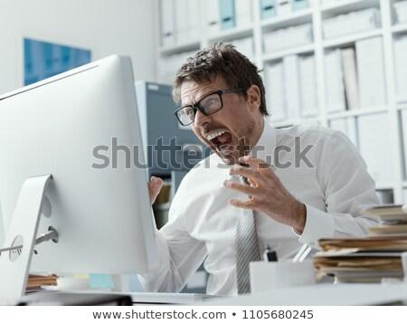 zangado · homem · computador · computador · portátil · punho · estúdio - foto stock © photohome