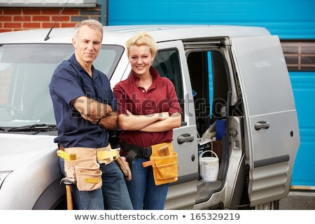 Male and female electricians working together Stock photo © photography33