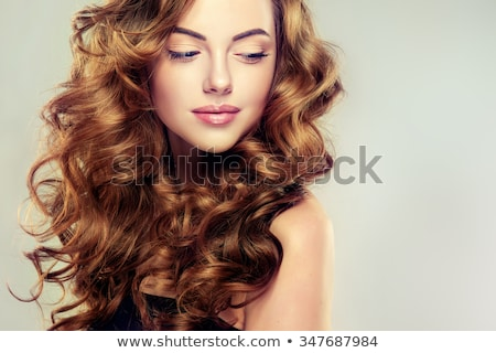beautiful woman with long brown curly hair stock photo © lubavnel