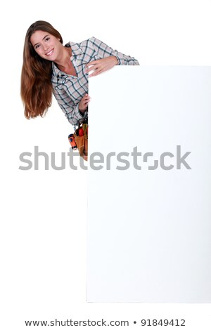 female builder stood with blank poster stock photo © photography33