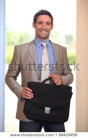 Zakenman huiselijk deuropening huis teken jeans Stockfoto © photography33