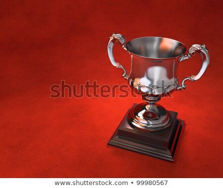 Trophy cup on plinth with red background Stock photo © sidewaysdesign
