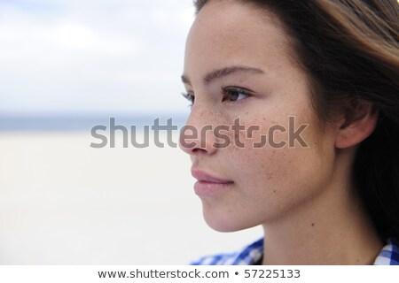 attractive woman at the sea facing the future Stock photo © mangostock