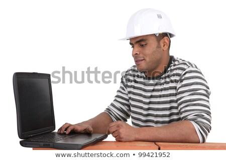строителя используя ноутбук бизнеса рук интернет здании Сток-фото © photography33