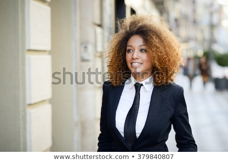 Portrait of a young woman wearing suit and tie Stock photo © photography33