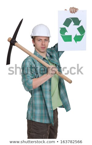 young bricklayer with pickaxe showing recycling logo Stock photo © photography33