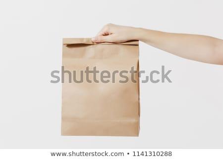 Torby papierowe człowiek brązowy papier worek zawartość Zdjęcia stock © Stocksnapper