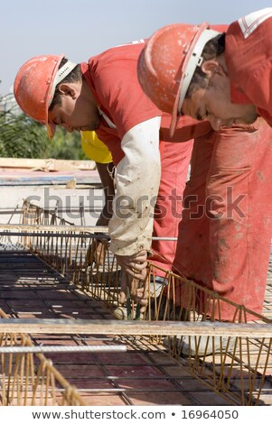 Construction worker crouching with metal Stock photo © photography33