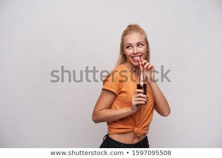 Lovely female posing while standing against a white background stock photo © wavebreak_media