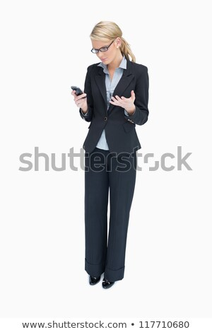 business woman standing and looking angrily at mobile phone stock photo © wavebreak_media