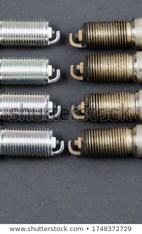 Four worn out spark plugs Stock photo © marekusz